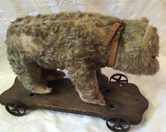 Antique mohair bear on wheels