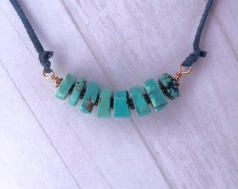 Turquoise necklace on leather