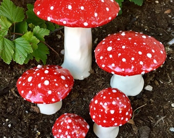 Five hand crafted ceramic toadstools - T136