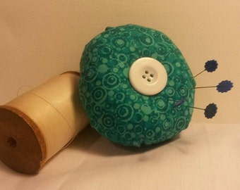 Handmade Pincushion in Recycled Turquiose Fabric with recycled white button
