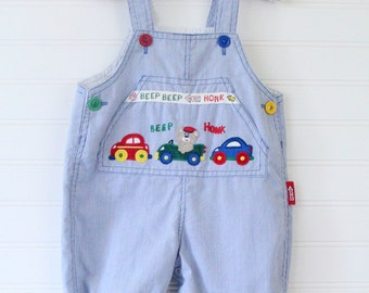 Vintage baby boy overalls. Blue overalls with cars on the chest pocket. no name sz 3-6 mo