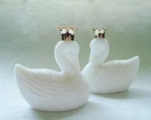 Pair of Vintage Avon White Swan Unforgettable Cologne Bottles