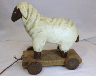 Hand Carved Hand Painted Folk Art Wooden Pull Toy of Sheep on Platform with Wheels