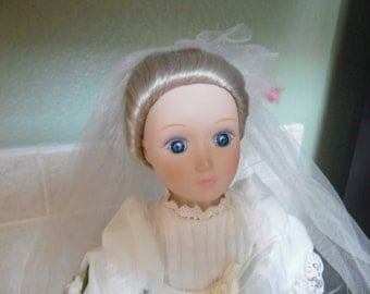 "Bride doll from different eras series.  14"", with stand.  Made in Taiwan. Empire bride, Margaret. Blonde hair and blue eyes"