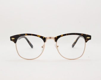 Clubmaster vintage style browline, clear lens, half frame glasses. Tortoise and gold frame spectacles. Prescription horn rimmed eyeglasses.