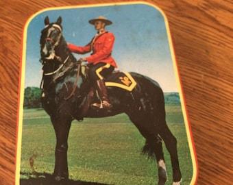 Vintage RCMP Mountie on Horseback Tin