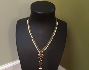 Ivory beads with wooden lariat