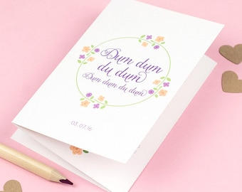 Floral wedding stationery with folded invitation, information and tear-off rsvp postcard