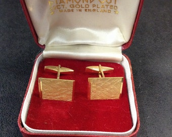 Gold plated cufflinks in box
