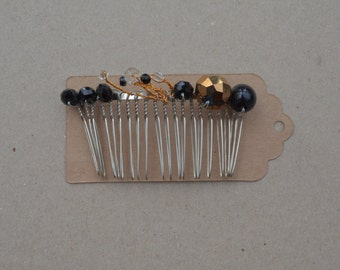 Black and copper hair comb.
