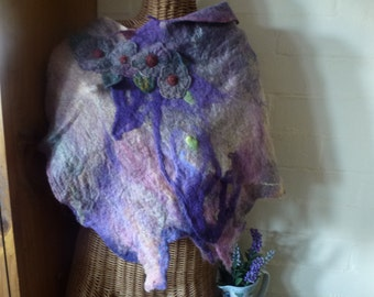 Hand dyed,  hand felted merino  poncho with needle  felted flower embellishment.