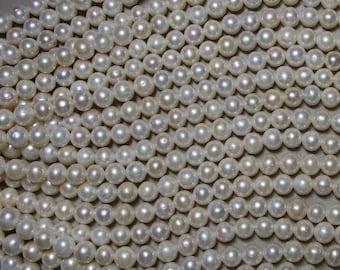 11-12mm #409 Near Round Pearls