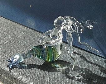 Glass mermaid sculpture