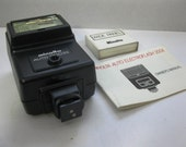 Minolta Auto 200X Flash with Wide Panel and Manual for Minolta X Series Cameras