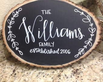 Personalized hand lettered family name chalkboard wood slice