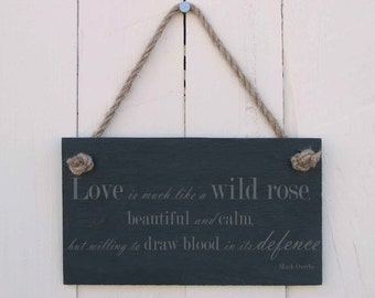 Slate Hanging Sign 'love is much like a wild rose, beautiful and clam, but willing to draw blood in its defence' (SR395)
