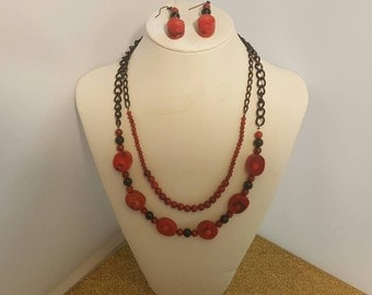 Red coral necklace and earrings. 206