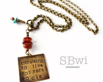 Too weird to live, too rare to die necklace in bronze with turquoise and garnet detail