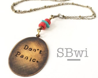Don't panic necklace in bronze with turquoise detail