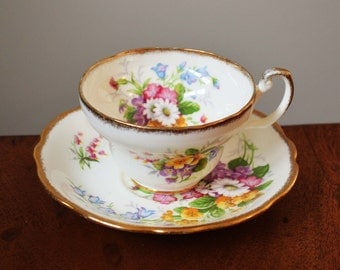 Antique Floral Foley Bone China teacup, made in England. Sweet summer roses, ivory white background