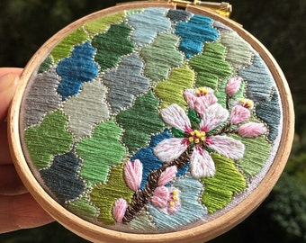 Hand Embroidered Artwork.  Almond Blossom Against Tiled Background
