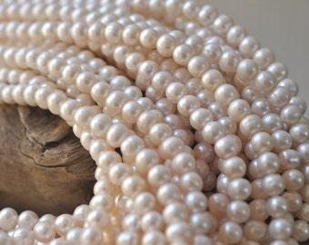 "White Off Round Pearls 7-8 MM 16"" Strand"