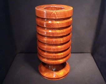 Decorative lathe turned wooden vase with glass insert.