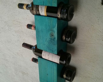 Wall wine rack for five bottles.. Package includes screws for wall mounting.
