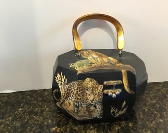 1960 box wood purse with big cats