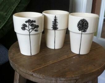 Hand-painted mug with tree illustration
