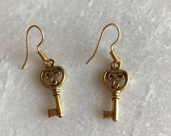 Gold tone key earrings
