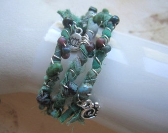 Silk Sari Ribbon Bracelet, Green Turquoise, expandable, memory wire, wire wrapped, beaded, swirl heart charm, lotus charm, silver