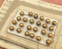 French 1900 haute couture buttons, gold metal, brass base, original sales card, jewellery millinery shoe costume design, vintage