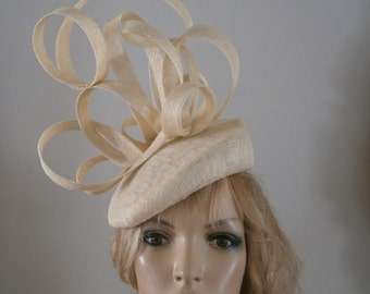 ivory perching beret hat embellished with hand sculptured loops