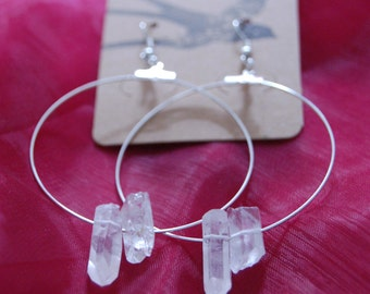 Clear crystals on silver hoop earrings