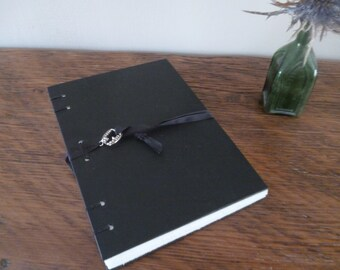 Hand bound black vampire notebook with fang charm, A6 Coptic stitch sketchbook, journal, blank bullet journal