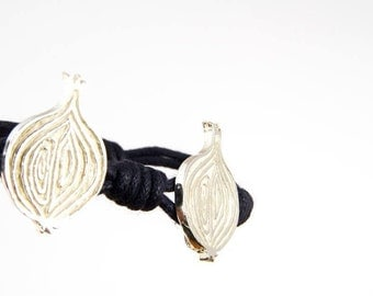 silver bracelet with 2 onions and waxed cord