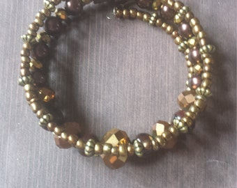 Tribal bronze and gold feather charm  bracelet