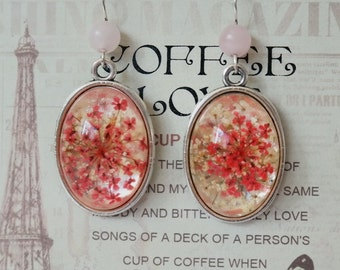 Cabochon earrings with pink flowers pattern