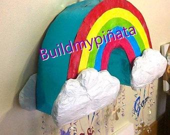 "Rainbow pinata,3D,26"" wide."