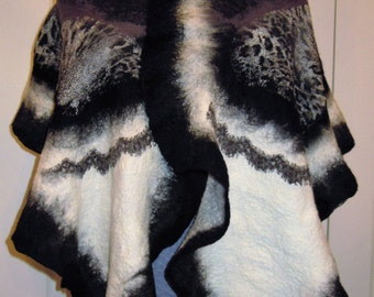 Nunofelted shawl is made of superfine merino wool, silk fabric, lase. Felted soft scarf in black, white, gray colors.