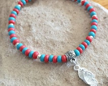 Child/teen/teen girl bracelet made with turquoise and coral Czech glass seed beads, silver tube bead and a flip-flop charm on elastic