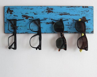 Eyewear Display: Sunglasses organiser with coastal blue, brown antique wood-grain finish and bungee cord