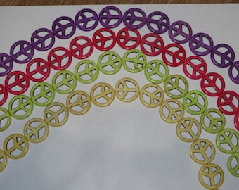 15 inch strand of Synthetic Carved Peace Shape Beads 24x24mm