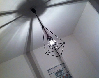 Black geometric suspension inspired by the Himmeli