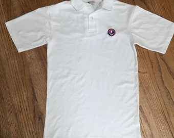 Grateful Dead Steal Your Face Polo Shirt, Woman's Size Small, White Polo with Grateful Dead embroidered Steal Your Face applique on front.