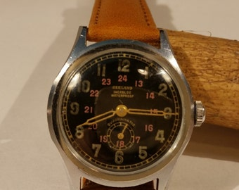 1940's Seeland Automatic Bumper Watch. Working refurbished condition.
