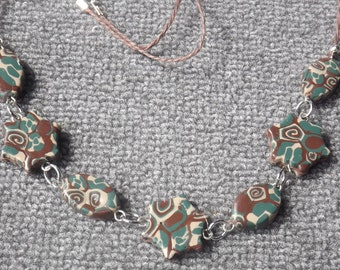 Polymer clay necklace Green / beige / brown,  with brown cord,  handmade.