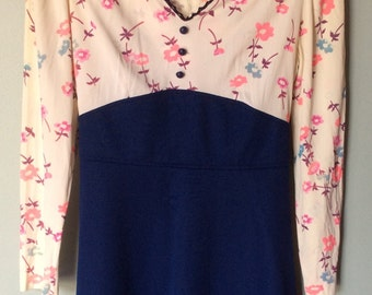 Vintage 1970's Empire Waist Dress, Featuring a Floral Bodice and a Dark Blue Skirt.