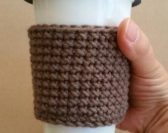 Crochet coffee cup cozy. Crocheted yarn coffee cup sleeve. Brown coffee cup cozy.